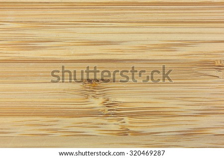 A close view of a used wood cutting board. - stock photo
