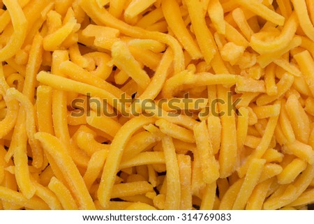 A close view of healthy and tasty shredded cheddar cheese. - stock photo