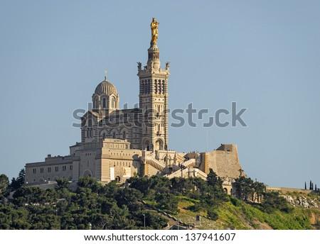 "A close view of the historic church ""Notre Dame de la Garde"" of Marseille in France - stock photo"