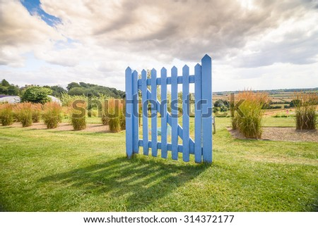 A closed gate in an open field. Could be used as, thinking outside the box, around a problem, psychology, careers, retirement, etc.. - stock photo