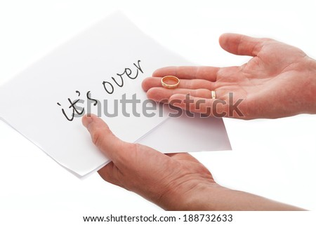 A closeup of a lover who has recieved a it's over note - stock photo