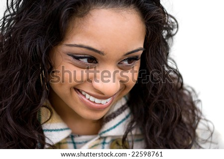 A closeup of a pretty Indian woman from a high angle.  Shallow depth of field with strong focus on the eyes and mouth. - stock photo