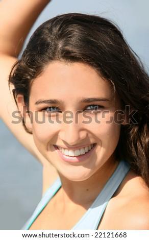 A Closeup of a smiling teenage girl - stock photo