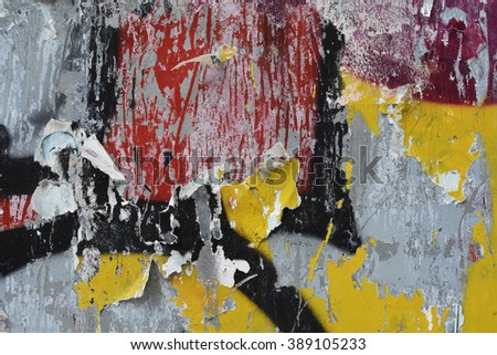 a closeup of a spraypaint and torn poster background - stock photo