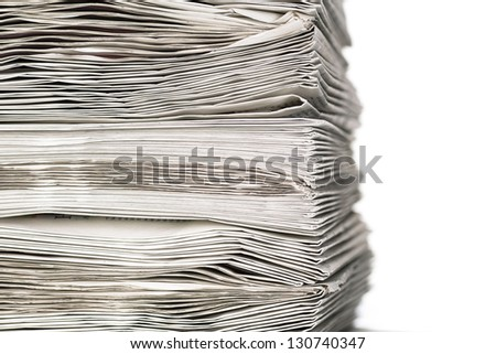 A closeup of a stack of newspapers - stock photo