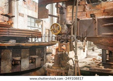 A closeup of an industrial grunge scene. Paint peeling of this metal construction - stock photo