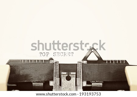 "A closeup of an old fashioned typewriter with the words ""TOP SECRET"" clearly visible. - stock photo"