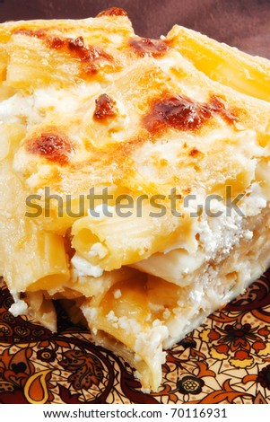 A closeup of delicious homemade mac and cheese (shallow dof) - stock photo