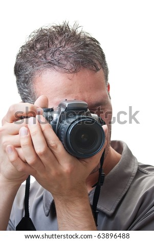 A closeup on the face of a man with a digital slr camera up to his eye, in the process of taking a picture, isolated on white. - stock photo
