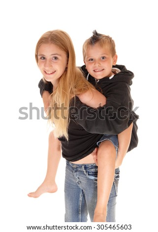 A closeup picture of a young girl caring her little brother on her back,smiling, isolated for white background. - stock photo