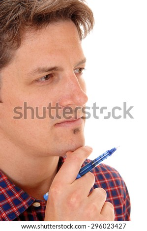 A closeup picture of a young man, holding a blue pen, in deep thoughts,isolated for white background. - stock photo