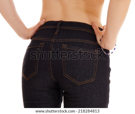 A closeup picture of the bottom of a young woman in jeans standing from the back, isolated for white background.  - stock photo