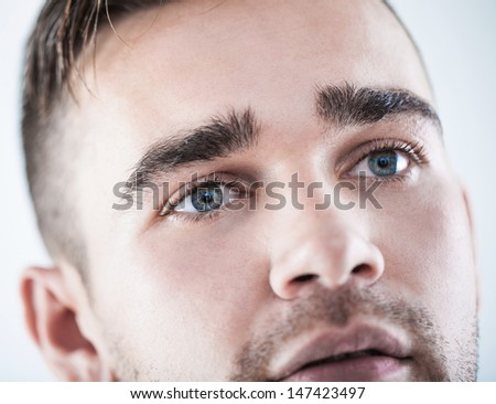 A closeup portrait of a handsome man with beautiful eyes - stock photo