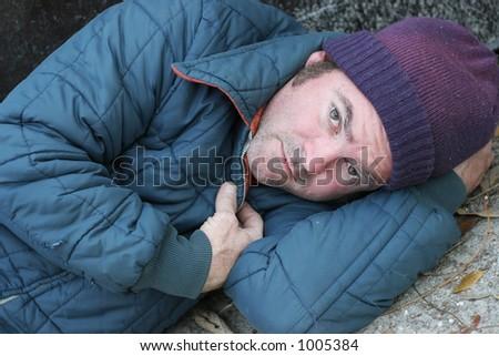 A closeup portrait of a homeless man. - stock photo