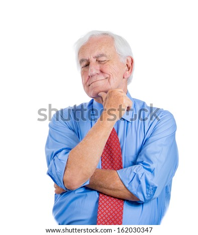 A closeup portrait of a senior executive, elderly man, grandfather with a very skeptical attitude, isolated on a white background. Human personalities and emotions, interpersonal conflict resolution. - stock photo