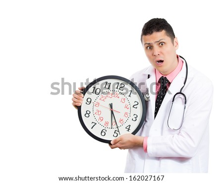 A closeup portrait of an overwhelmed with busy schedule, unhappy male health care professional doctor or nurse holding big clock running out of time isolated on white background with a copy space. - stock photo
