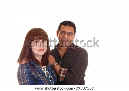 A closeup shoot of a mixed couple, Hispanic and Caucasian, she with red hair, blue shirt and necklace, standing for white background. - stock photo