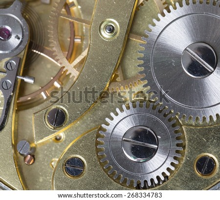 A closeup shot from a clock's clockwork. - stock photo
