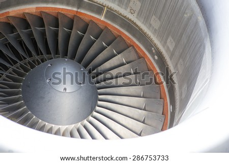 A closeup shot of a jet engine from 'C-17'. Image taken on a cloudy day at the airport and with a long telephoto lens. - stock photo