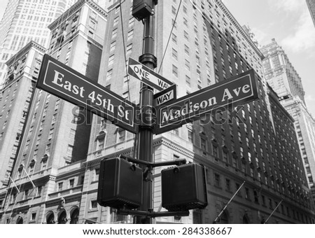 A closeup to signs for East 45th and Madison Avenue in New York City - stock photo