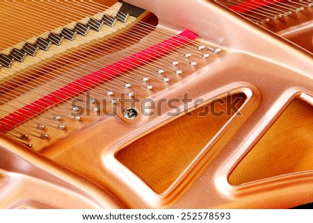 A closeup view of a modern soundboard in a grand piano. - stock photo