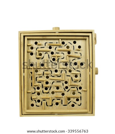 A closeup view of a wooden labyrinth game - stock photo