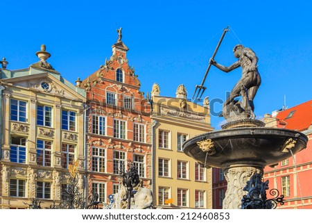 A closup of Neptune statue in Gdansk with colorful houses in the background, Poland - stock photo
