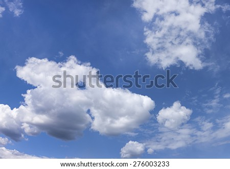 A cloud takes the shape of an animal. - stock photo