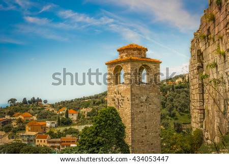 A cloudy evening in the mountains. The completion of the archaeological expedition. Ruins of the ancient city in the mountains in the evening. Foggy view of old stone buildings and streets. - stock photo
