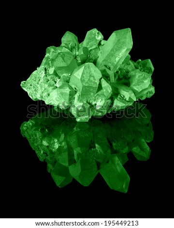 A cluster of well developed green limonite quartz crystals with their reflection. - stock photo