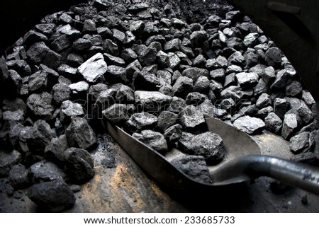 A coal shovel in an old vintage steam train. - stock photo