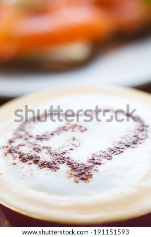 A coffee art heart on a milk froth - stock photo
