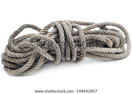 a coil of old hemp rope on a white background - stock photo