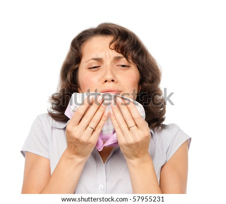 A cold girl sneezes - stock photo