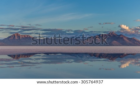 A cold night breaks on the Bonneville Salt Flats - stock photo