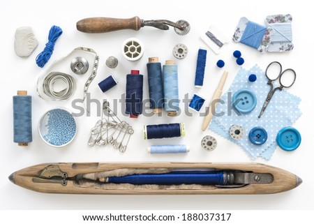 a collection needle work accessories in blue on white background - stock photo