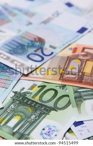 A collection of 20, 50 and 100 euro bank notes - stock photo