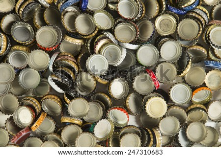 a collection of beer bottle caps representing the craft beer industry - stock photo