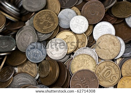 A collection of coins from different countries - stock photo