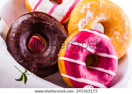 a collection of delicious and colorful donuts on a plate - stock photo