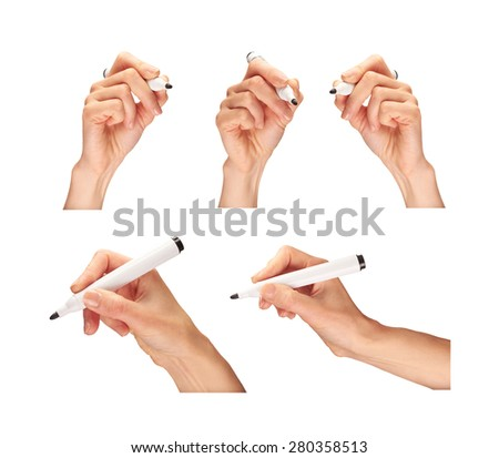 A collection of female hands holding a marker pen. - stock photo