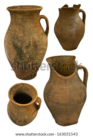 A collection of historic handmade earthenware isolated on white - stock photo