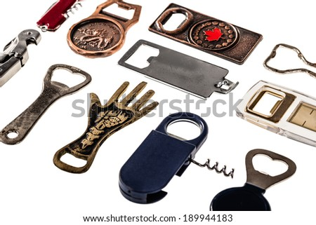 a collection of many different bottle openers isolated on a white background - stock photo