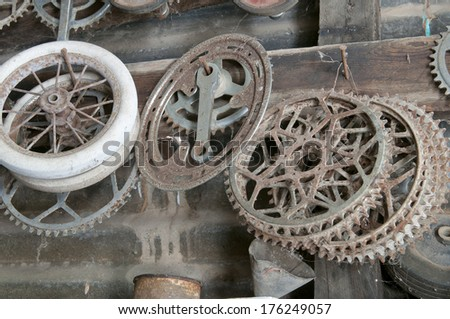 A collection of old bicycle parts hanging in a shed - stock photo