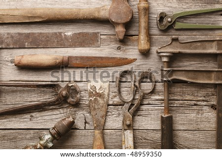 A collection of old rusty tools - stock photo