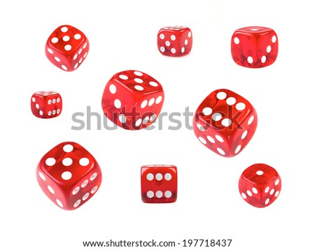 A collection of red dice at different angles isolated on a white background. - stock photo