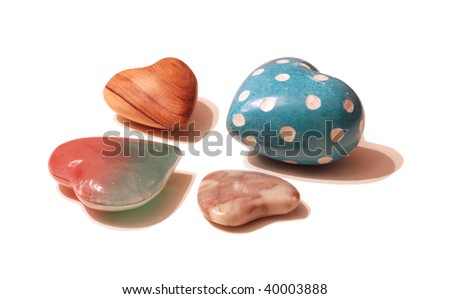 A collection of 4 small hearts on white - stock photo