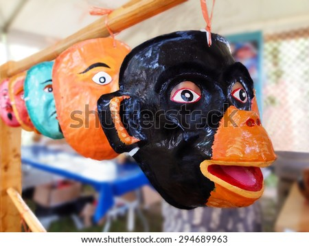 A collection of Three Kings Day masks, crafted of flour paste, sugar, and glue, and hand painted, on display