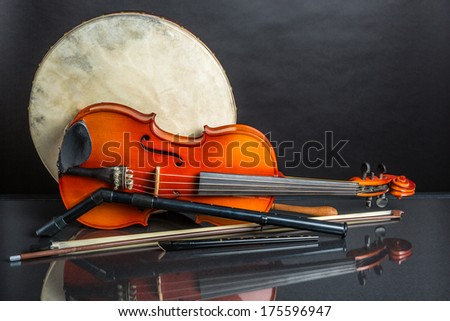 A collection of traditional Irish musical instruments on a black background - stock photo
