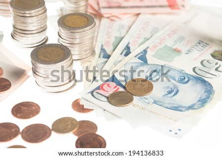 a collection of various currencies from countries the globe in white background - stock photo